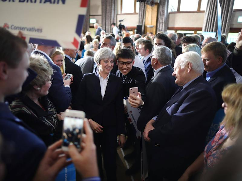 Even Theresa May gets stopped by fans for selfies: Getty