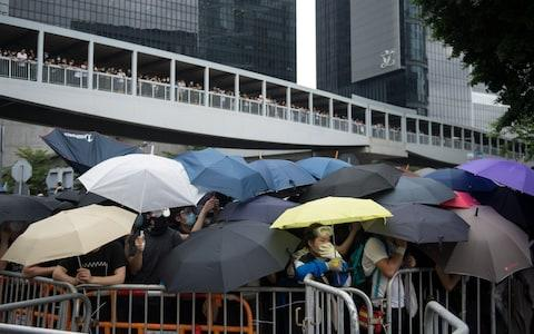 Demonstrators gather to show opposition to amendments to extradition law in Hong Kong - Credit: Rex