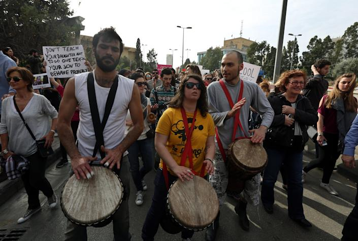 Lebanese citizens beat drums during a rally by thousands to mark International Woman's Day demanding that parliament approves a law that protects women from domestic violence, in Beirut, Lebanon, Saturday, March 8, 2014. Although Lebanon appears very progressive on women rights compared to other countries in the Middle East, domestic violence remains an unspoken problem and the nation's parliament has yet to vote on a bill protecting women's rights nearly three years after it was approved by the Cabinet. (AP Photo/Bilal Hussein)