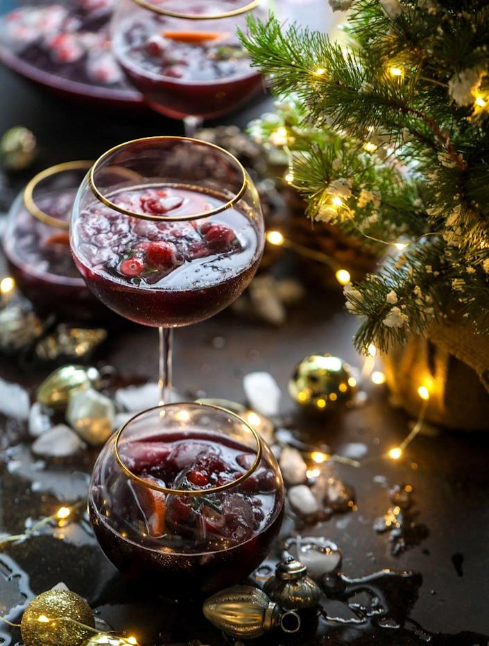 """<p>Like the name suggests, make this punch to enjoy while decorating. It calls for creative, unexpected ingredients like Lambrusco and orange liqueur.</p><p><strong>Get the recipe at <a href=""""https://www.howsweeteats.com/2018/11/christmas-punch/"""" rel=""""nofollow noopener"""" target=""""_blank"""" data-ylk=""""slk:How Sweet Eats"""" class=""""link rapid-noclick-resp"""">How Sweet Eats</a>.</strong> </p>"""