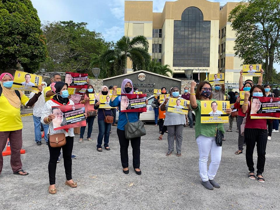 Lim Guan Eng's supporter are seen with placards outside the Butterworth courthouse August 11, 2020. — Picture by Steven KE Ooi