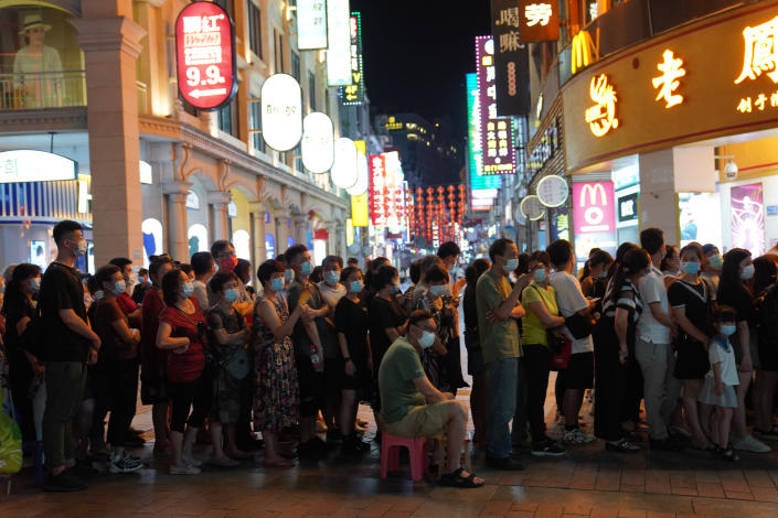 Residents line up for coronavirus testing in the Liwan District in Guangzhou in southern China's Guangdong province on Wednesday May 26, 2021. The southern Chinese city of Guangzhou shut down a neighborhood and ordered its residents to stay home Saturday for door-to-door coronavirus testing following an upsurge in infections that has rattled authorities.(AP Photo)