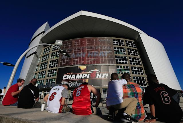 MIAMI, FL - OCTOBER 30: Fans wait for the doors to open to the American Airlines Arena prior to the season opener between the Miami Heat and the Boston Celtics at American Airlines Arena on October 30, 2012 in Miami, Florida. NOTE TO USER: User expressly acknowledges and agrees that, by downloading and or using this Photograph, user is consenting to the terms and conditions of the Getty Images License Agreement. (Photo by Chris Trotman/Getty Images)
