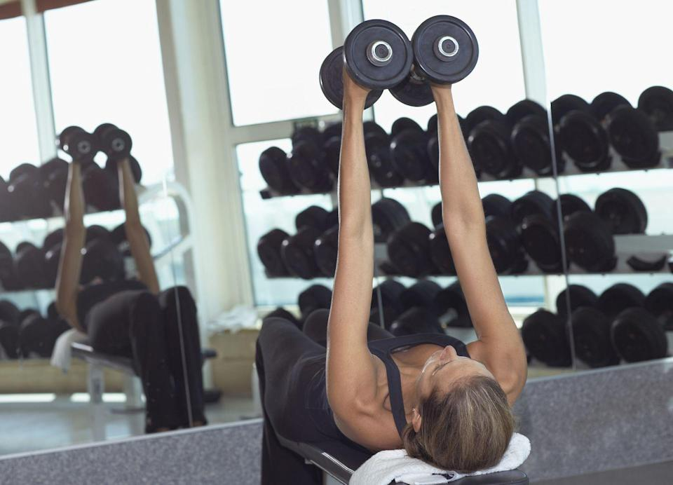 <p>This narrow grip variation allows you to work the chest and get some tricep action in too.</p><p><strong>How to: </strong>Hold a dumbbell in each hand and rest it on your thighs as you lay supine on a flat bench with your feet pressing into the floor. If you are on the floor, bend your knees. Your head, shoulders, and butt should make contact with the bench or floor for the whole movement. Draw your shoulders back and down, and lift the dumbbells overhead so they are touching in a narrow position and in line with your chest. Inhale as you lower the dumbbells down to the middle of your chest slow and controlled, keeping them together. Then exhale as you push them back up together towards the ceiling.</p>