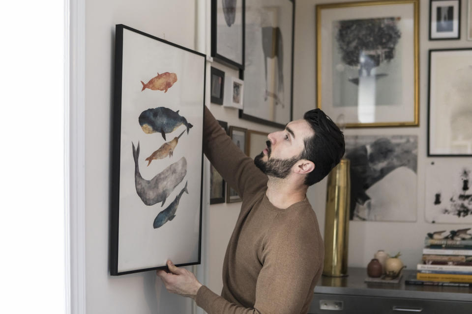 Whether you are putting your own art or photography to the skills or buying prints, adding fun slogans, paintings or graphics instantly make for a talking point when you have guests over, and add a bit of your personality to a room. (Getty Images)