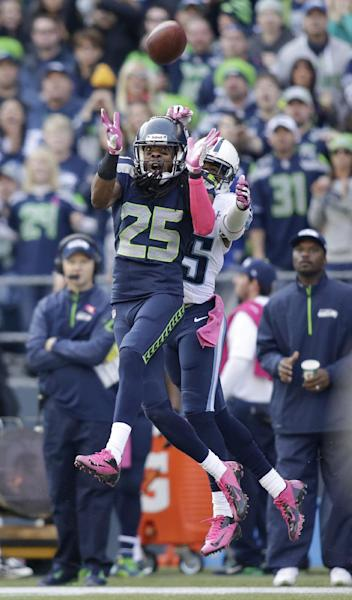 Seattle Seahawks cornerback Richard Sherman (25) intercepts a pass intended for wide receiver Nate Washington, right, during the second half of an NFL football game, Sunday, Oct. 13, 2013, in Seattle. (AP Photo/Scott Eklund)