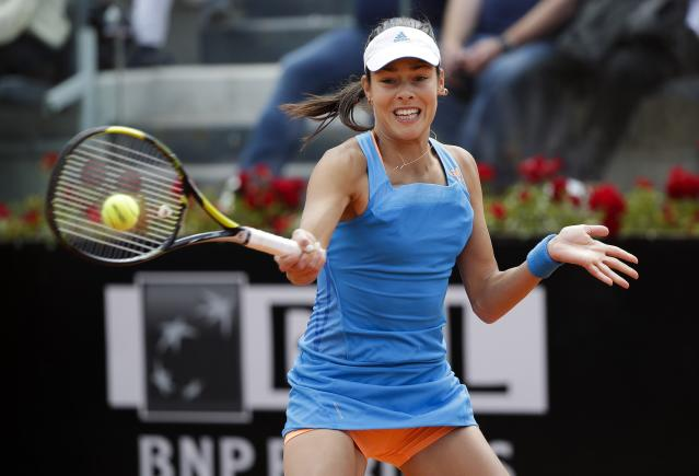 Ivanovic of Serbia hits a return to Sharapova of Russia during their women's singles match at the Rome Masters tennis tournament