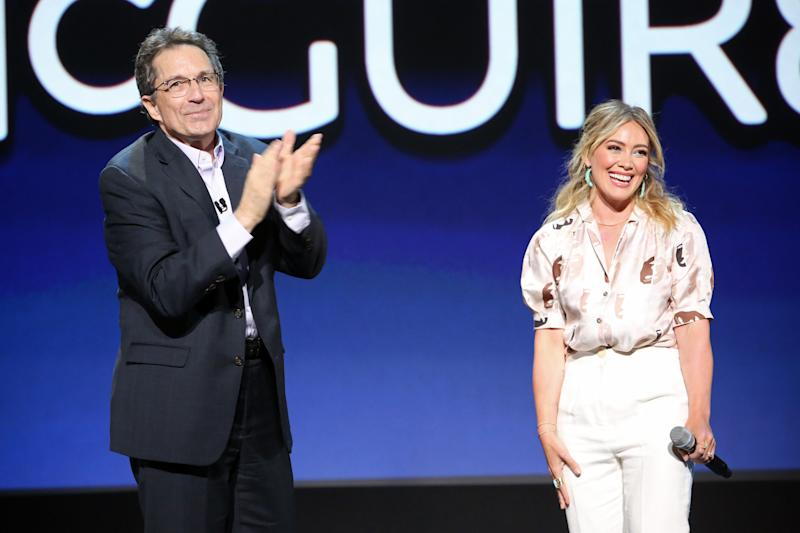 ANAHEIM, CALIFORNIA - AUGUST 23: (L-R) Kenny Ortega and Hilary Duff of 'Lizzie McGuire' took part today in the Disney+ Showcase at Disney's D23 EXPO 2019 in Anaheim, Calif. 'Lizzie McGuire' will stream exclusively on Disney+, which launches November 12. (Photo by Jesse Grant/Getty Images for Disney)