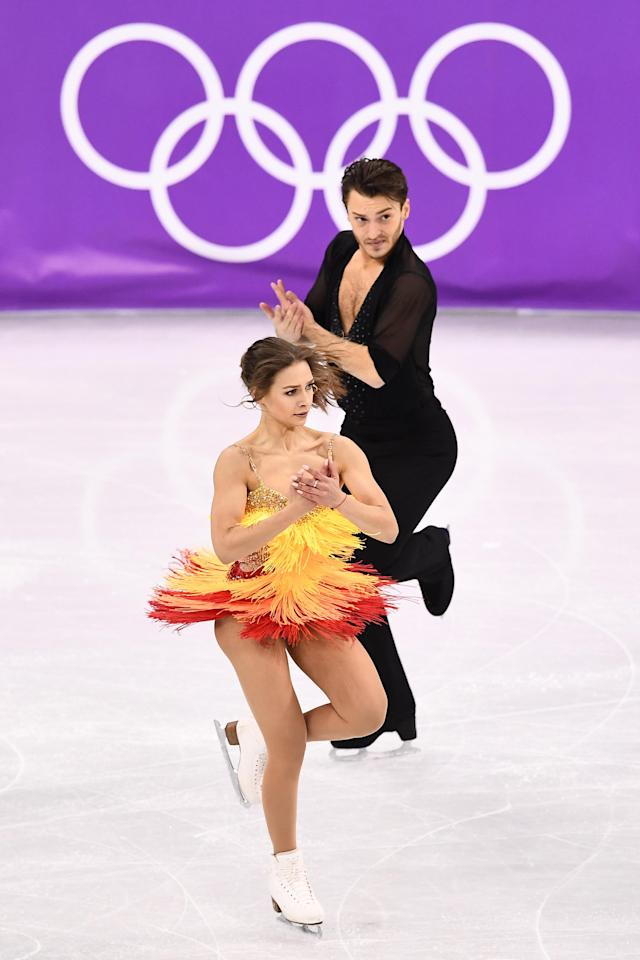 <p>Germany's Kavita Lorenz and Germany's Joti Polizoakis compete in the ice dance short dance of the figure skating event during the Pyeongchang 2018 Winter Olympic Games at the Gangneung Ice Arena in Gangneung on February 19, 2018. / AFP PHOTO / ARIS MESSINIS </p>