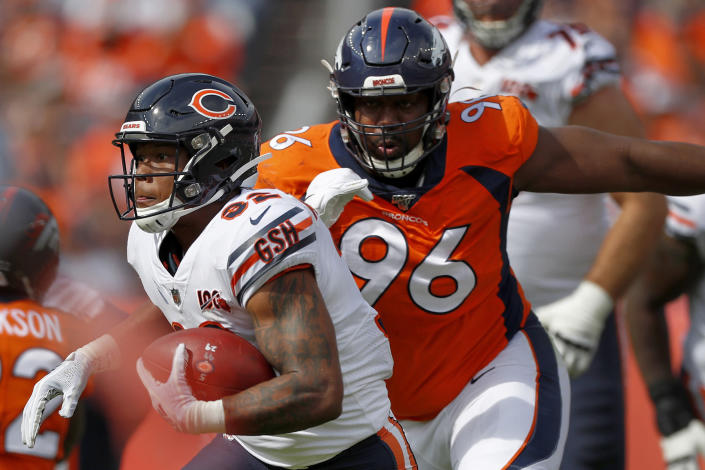 FILE - Chicago Bears running back David Montgomery is pursued by Denver Broncos defensive tackle Shelby Harris during the first half of an NFL football game in Denver, in this Sunday, Sept. 15, 2019, file photo. After missing four games because of COVID-19, Harris will return to the Broncos' lineup when Denver travels to Kansas City to face the Chiefs on Sunday evening. (AP Photo/David Zalubowski, File)