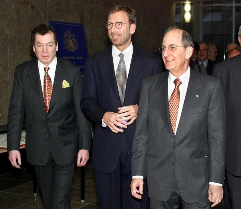 Seagram Company Limited President and CEO Edgar Bronfman Jr. (C) is flanked by his father Edgar Bron..