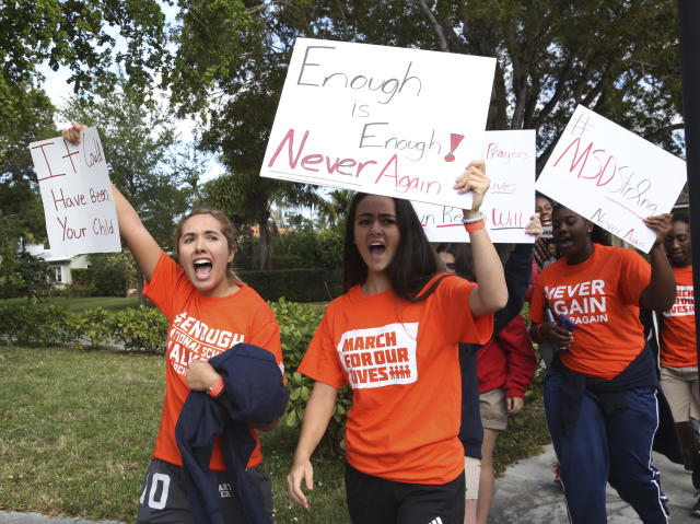 <p>Students from Miami County Day School walk out of their school to protest gun violence in Miami Shores, Fla., Wednesday, March 14, 2018. Students from all over the country rallied to continue to put pressure on state and federal lawmakers to enact gun control and school safety legislation. The day marks one month since a gunman killed 17 students and faculty at Marjory Stoneman Douglas High School in Parkland, Fla. (Photo: Marta Lavandier/AP) </p>