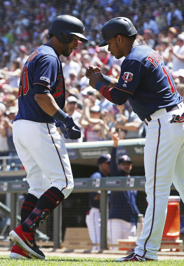 Minnesota Twins' Eddie Rosario, left, is greeted is greeted by Jorge Polanco, right, after Rosario's three-run home run off Chicago White Sox pitcher Dylan Covey in the third inning of a baseball game Sunday, May 26, 2019, in Minneapolis. (AP Photo/Jim Mone)