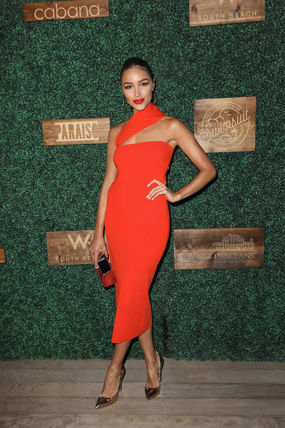 <p>Olivia Culpo attended the 2018 Sports Illustrated Swimsuit show on 15 July in a red midi dress. <em>[Photo: Getty]</em> </p>