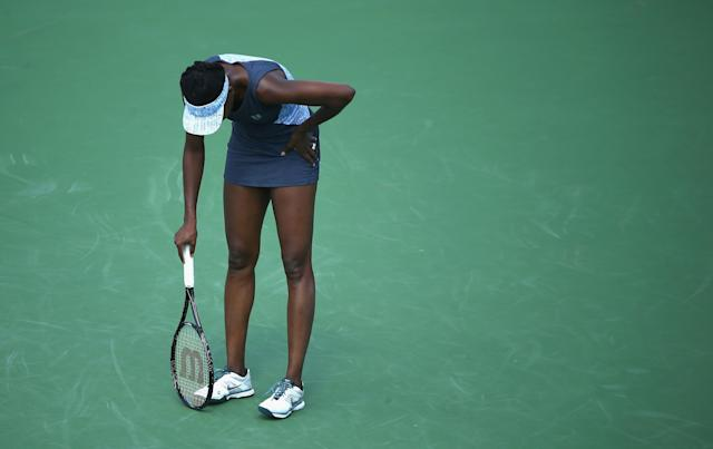 Venus Williams of the US reacts to losing a point to Luci Safarova of the Czech Republic, during the Western & Southern Open, at the Lender Family Tennis Center in Cincinnati, Ohio, on August 12, 2014 (AFP Photo/Andy Lyons)