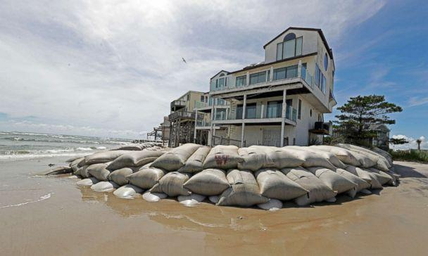 PHOTO: Sand bags surround homes on North Topsail Beach, N.C., Sept. 12, 2018, as Hurricane Florence threatens the coast. (Chuck Burton/AP)