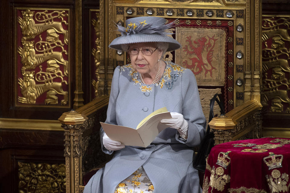 Britain's Queen Elizabeth II reads the Queen's Speech on the The Sovereign's Throne in the House of Lords chamber,, during the State Opening of Parliament at the Houses of Parliament in London on May 11, 2021, which is taking place with a reduced capacity due to Covid-19 restrictions. - The State Opening of Parliament is where Queen Elizabeth II performs her ceremonial duty of informing parliament about the government's agenda for the coming year in a Queen's Speech. (Photo by Eddie MULHOLLAND / POOL / AFP) (Photo by EDDIE MULHOLLAND/POOL/AFP via Getty Images)