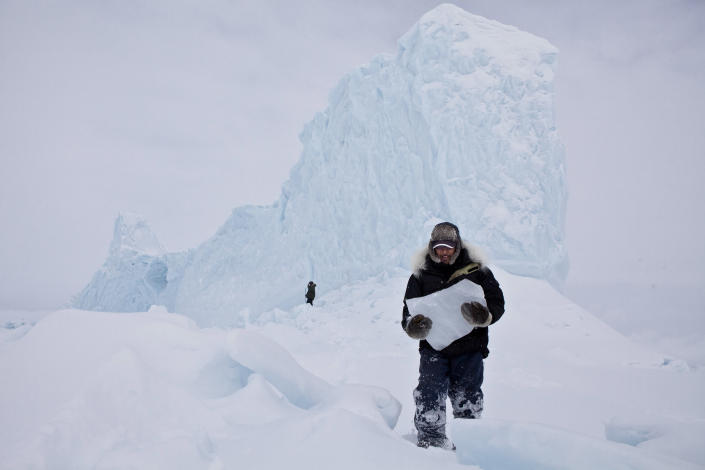 """<b>Viewers' Choice for Places: Iceberg Hunters</b> <br> Chipping ice off an iceberg is a common way for the Inuit community to retrieve fresh drinking water while on the land. During a weekend long hunting trip, we came upon this majestic iceberg frozen in place. It was a perfect opportunity to grab enough ice and drinking water for the remainder of the trip. <a href=""""http://ngm.nationalgeographic.com/ngm/photo-contest/"""" rel=""""nofollow noopener"""" target=""""_blank"""" data-ylk=""""slk:(Photo and caption by Adam Coish/National Geographic Photo Contest)"""" class=""""link rapid-noclick-resp"""">(Photo and caption by Adam Coish/National Geographic Photo Contest)</a>"""