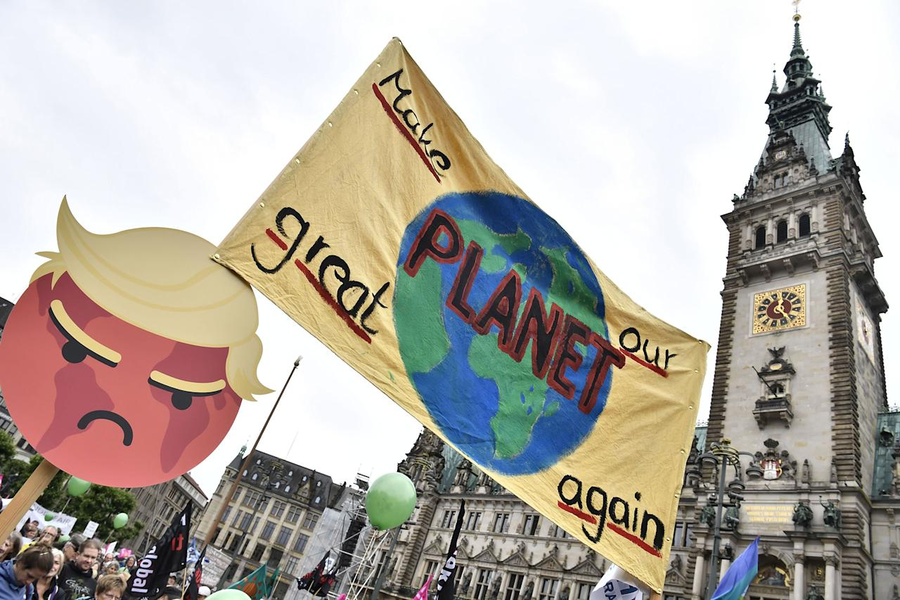 <p>A banner is lifted in front of the Hamburg city hall (Rathaus) during a demonstration called by several NGOs ahead of the G20 summit in Hamburg on July 2, 2017. (John MacDougall/AFP/Getty Images) </p>