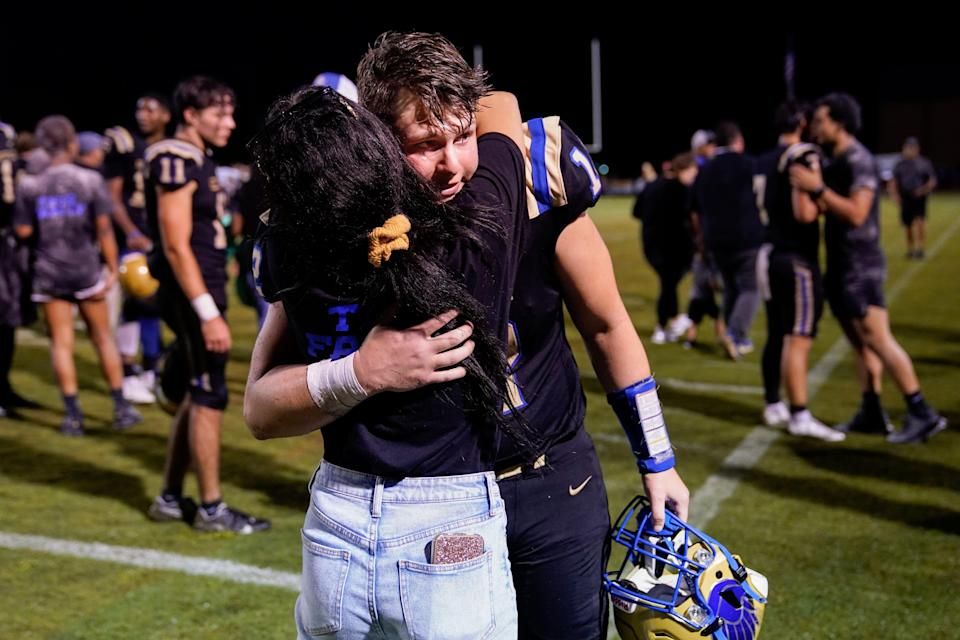Cayden greets his girlfriend, Kinley Isbell, after the game. His team lost, but he had much to celebrate.