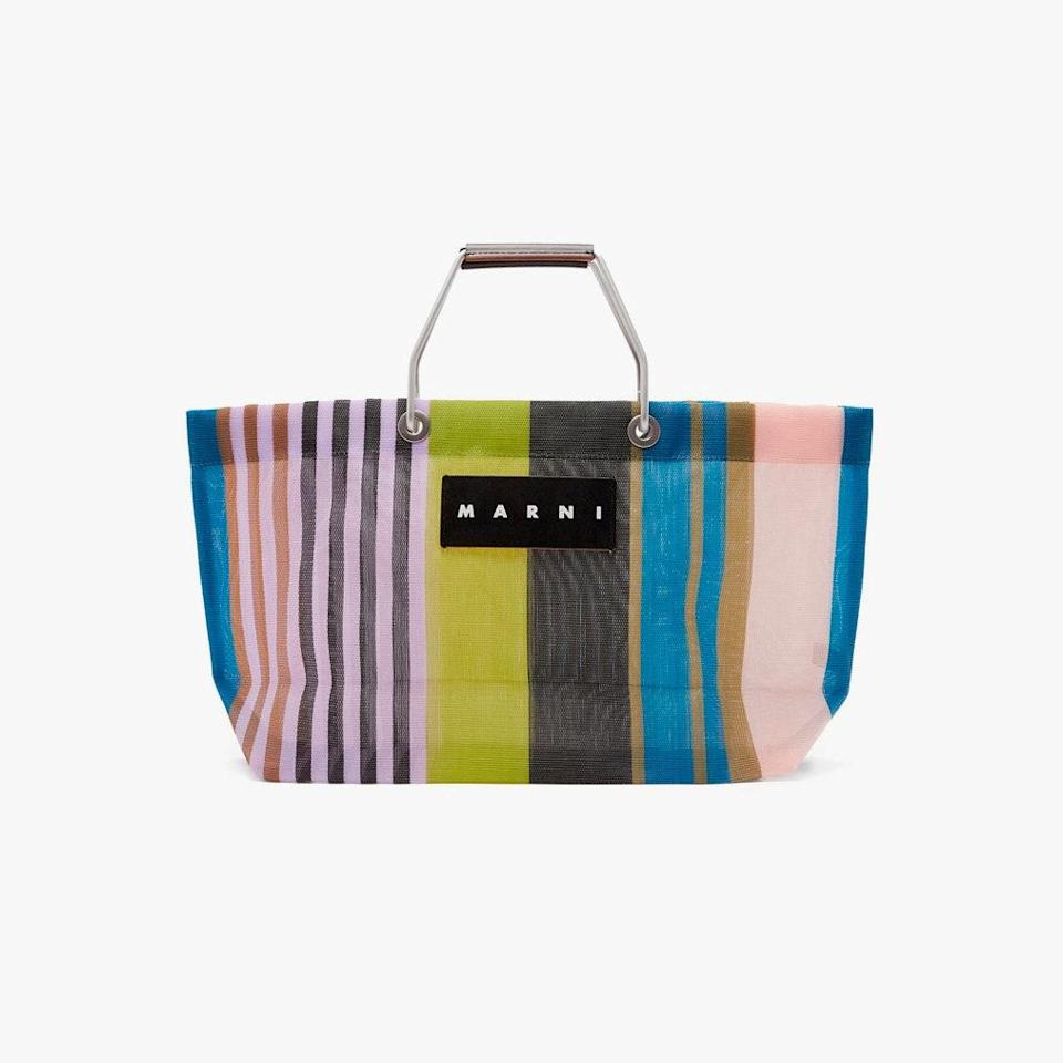 """$130, MATCHESFASHION.COM. <a href=""""https://www.matchesfashion.com/us/products/Marni-Market-Mini-striped-nylon-tote-bag-1447265"""" rel=""""nofollow noopener"""" target=""""_blank"""" data-ylk=""""slk:Get it now!"""" class=""""link rapid-noclick-resp"""">Get it now!</a>"""