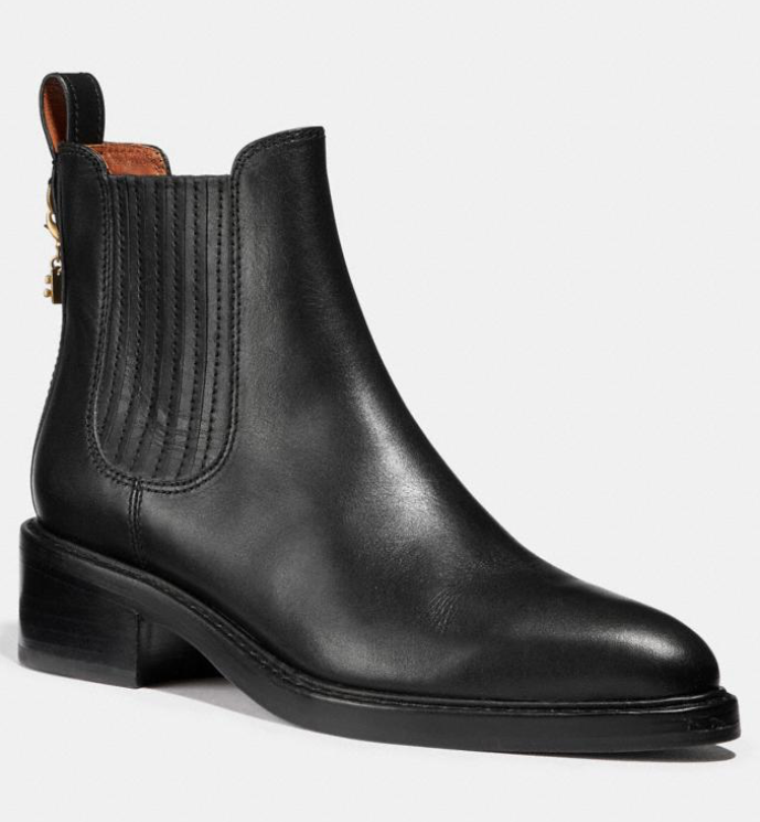 If you're investing in a pair of shoes this season, make it a pair of black booties. (Photo: Coach)