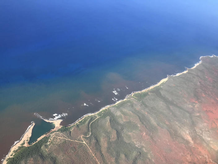In this 2020 aerial photo provided by the Arizona State University's Global Airborne Observatory, runoff from the island of Molokai in Hawaii flows into the ocean. Recent flooding in Hawaii caused widespread and obvious damage. But extreme regional rain events that are predicted to become more common with global warming do not only wreak havoc on land, the runoff from these increasingly severe storms is also threatening Hawaii's coral reefs. (Global Airborne Observatory, Arizona State University via AP)
