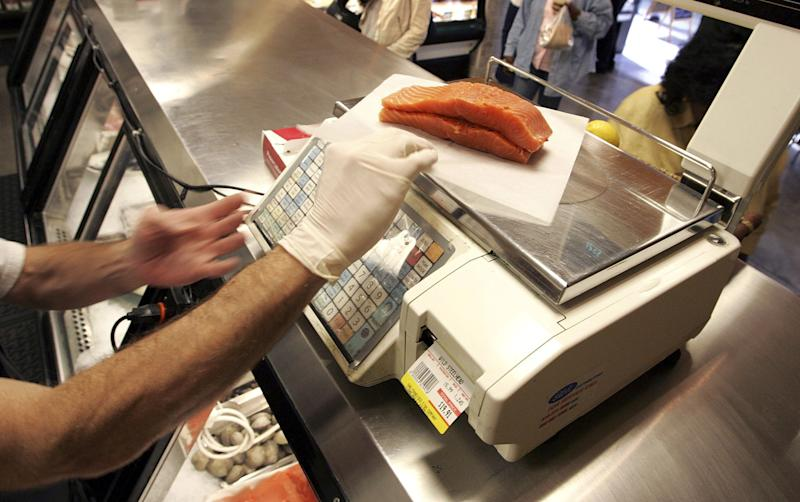 An employee at a San Francisco fish market weighs salmon filets on October 17, 2006