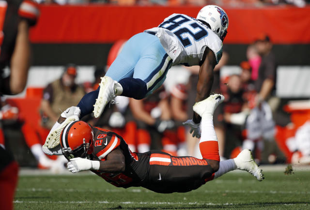 <p>Cleveland Browns strong safety Derrick Kindred (26) tackles Tennessee Titans tight end Jonnu Smith (81) in the second half of an NFL football game, Sunday, Oct. 22, 2017, in Cleveland. (AP Photo/Ron Schwane) </p>