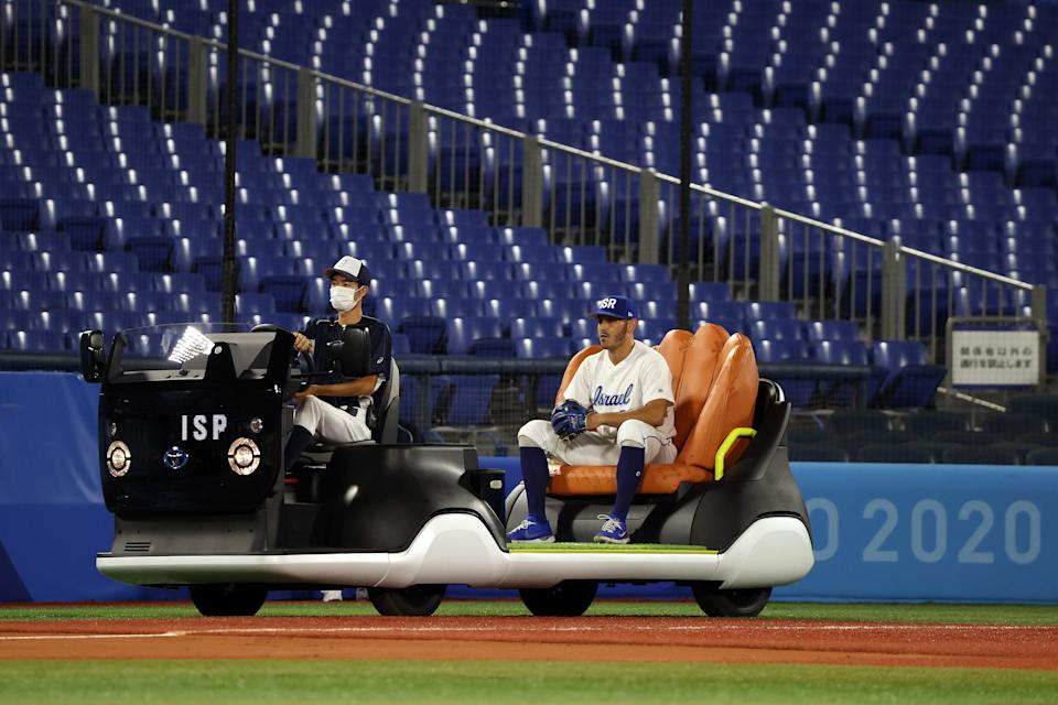 YOKOHAMA, JAPAN - JULY 30: Jonathan De Marte #21 of Team Israel enters the game from the bullpen cart in the sixth inning against Team United States during the baseball opening round Group B game on day seven of the Tokyo 2020 Olympic Games at Yokohama Baseball Stadium on July 30, 2021 in Yokohama, Kanagawa, Japan. (Photo by Yuichi Masuda/Getty Images)