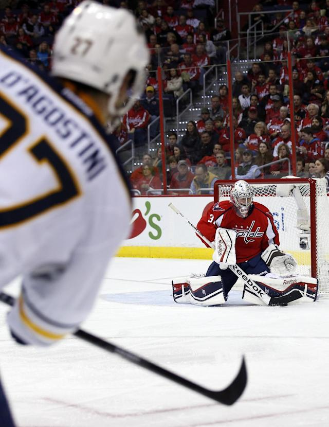 Washington Capitals goalie Philipp Grubauer (31), from Germany, stops a shot by Buffalo Sabres right wing Matt D'Agostini (27) in the second period of an NHL hockey game, Sunday, Jan. 12, 2014, in Washington. (AP Photo/Alex Brandon)