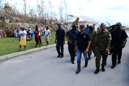 Government officials survey the grounds of the Government Complex in the aftermath of Hurricane Dorian in Marsh Harbour