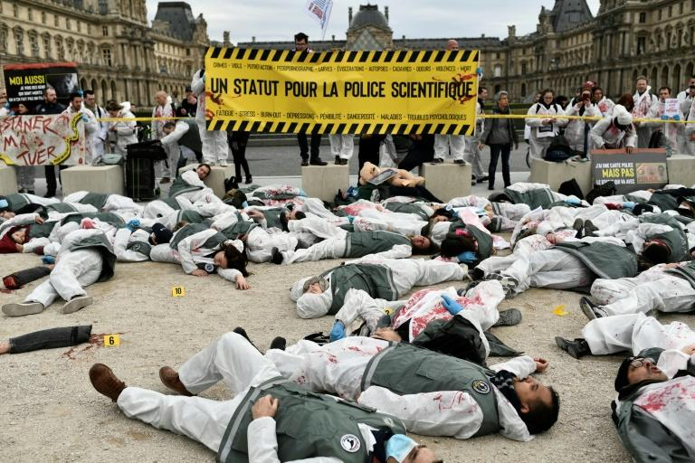 Dead bodies and bloody limbs piled up outside the Louvre in Paris as protesting forensic investigators staged a crime scene, horrific but fake, to demand the same labour benefits as their colleagues in blue (AFP Photo/STEPHANE DE SAKUTIN)