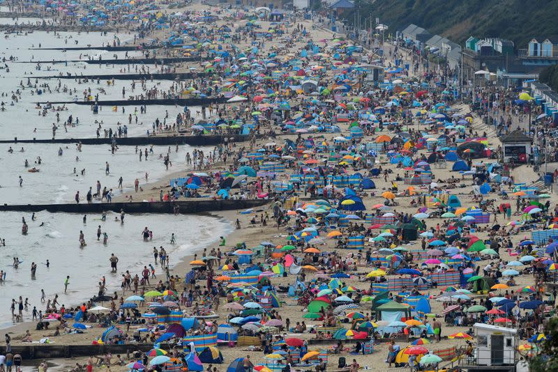 FILE PHOTO: People enjoy the sunny weather at the Bournemouth Beach, amid the coronavirus disease (COVID-19) outbreak, in Bournemouth