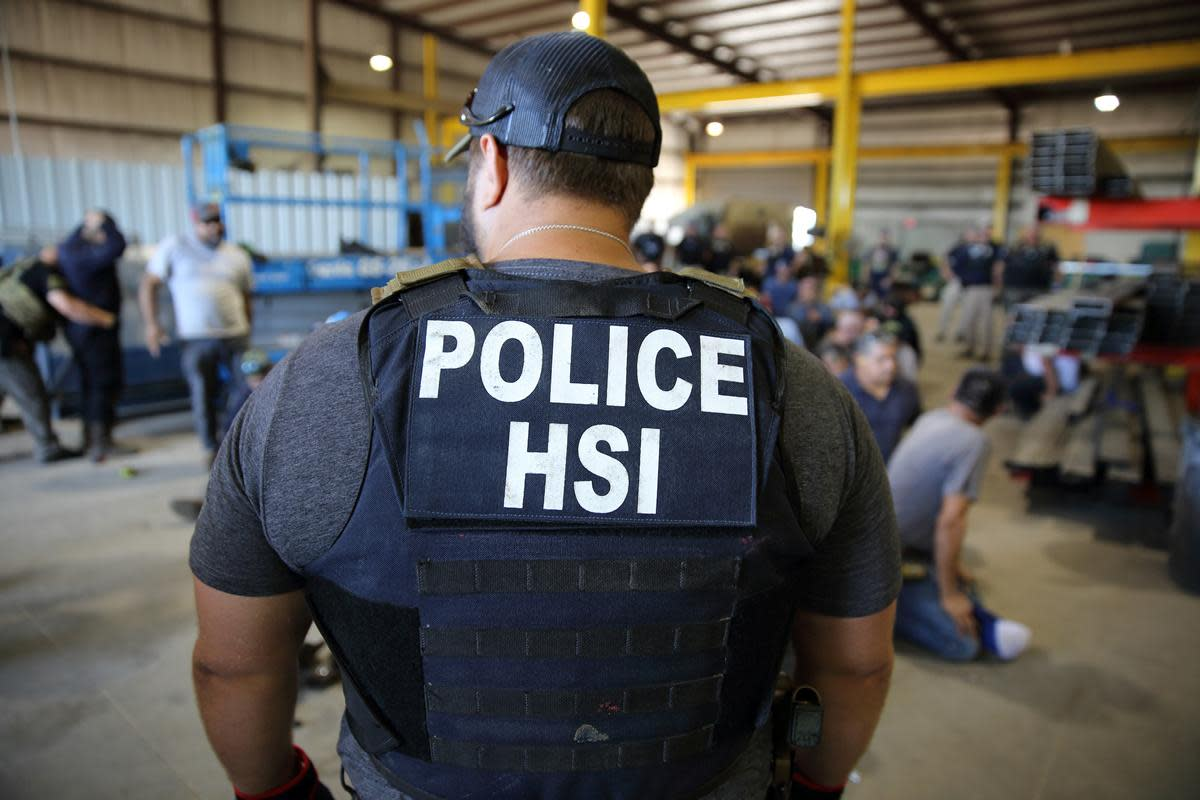 Homeland Security Investigations (HSI) officers arrest more than 100 employees on federal immigration violations at a trailer manufacturing business in Sumner, Texas, last year. (Photo: U.S. Immigration and Customs Enforcement/Handout via Reuters)