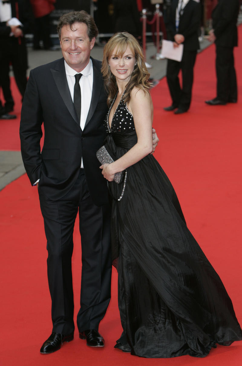 Former British newspaper editor and reality television star Piers Morgan, left, and British actress Amanda Holden arrive for the BAFTA television awards in London, Sunday April 20, 2008. (AP Photo/Nathan Strange)