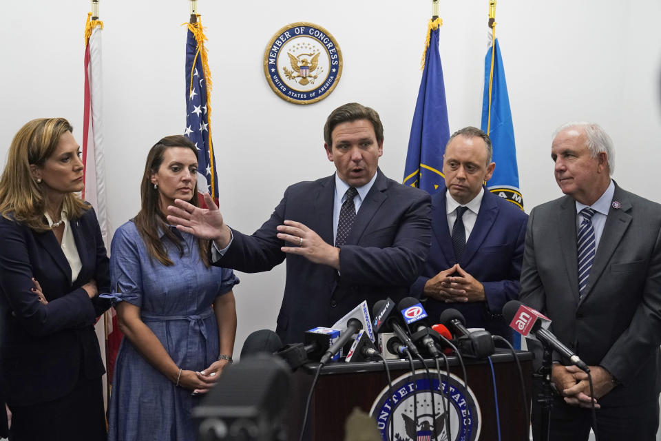 Florida Gov. Ron DeSantis, center, speaks during a news conference at the offices of Rep. Maria Elvira Salazar, left, R-Fla., along with Lt. Gov. Jeanette Nunez, second from left, Marcell Felipe, second from right, founder of the Inspire America Foundation, an organization dedicated to promoting democracy in Cuba and the Americas, and Rep. Carlos Gimenez, R-Fla., Thursday, July 15, 2021, in Miami. DeSantis and other officials pressed the White House on Thursday to support efforts to preserve internet service to antigovernment protesters in Cuba, even advocating the use of giant balloons as floating Wi-Fi hotspots to allow images of dissent to stream unabated from the authoritarian nation. (AP Photo/Wilfredo Lee)