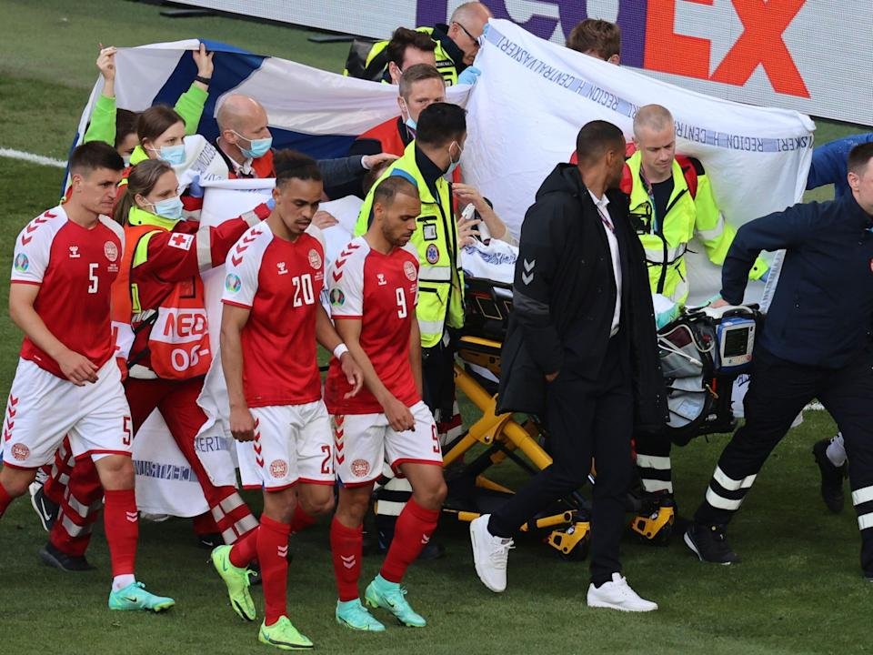 Christian Eriksen carted off the field at Euro 2020.