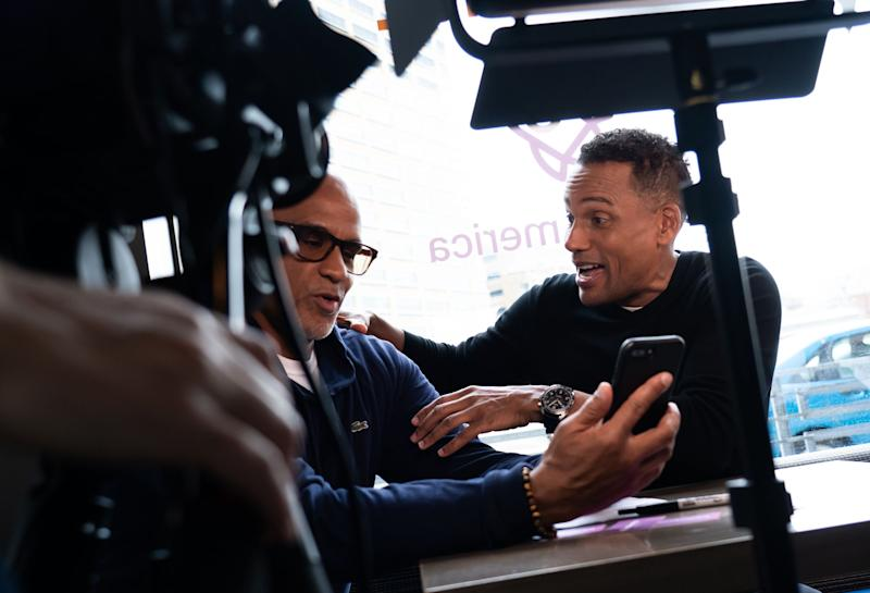 """Actor Hill Harper (right) is filmed talking with Matthew Evans of Grosse Pointe while doing promotion about """"Credit over Coffee"""" as part of an effort to build credit scores through a new program called Experian Boost at his business the Roasting Plant Coffee in downtown Detroit on Wednesday, May 1, 2019."""