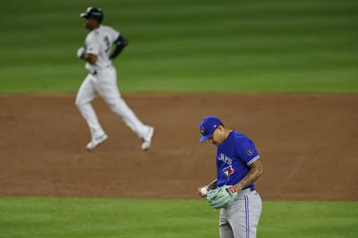 Toronto Blue Jays pitcher Taijuan Walker waits after giving up a solo home run to New York Yankees' Aaron Hicks during the second inning of a baseball game Tuesday, Sept. 15, 2020, in New York. (AP Photo/Adam Hunger)