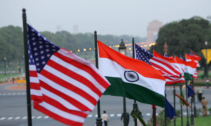 FILE - In this Feb. 27, 2006, file photo, U.S. and Indian flags flutter near the Presidential Palace in New Delhi, India, ahead of then U.S. President George W. Bush's visit to the country. India has high hopes its ties with the United States will deepen under President Joe Biden, who was a key proponent of the 2008 civil nuclear deal between the countries and whose new administration includes several Indian Americans. (AP Photo/Gurinder Osan, File)