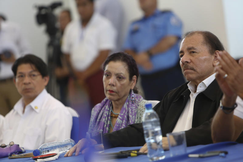 FILE - In this May 16, 2018 file photo, Nicaragua's President Daniel Ortega, right, and Vice-President and first lady Rosario Murillo attend the opening of a national dialogue, in Managua, Nicaragua. The Vatican's diplomatic envoy to Nicaragua said Thursday, Aug. 1, 2019, that he has received a letter from President Daniel Ortega's government apparently saying talks with the opposition on resolving the country's more than year-old political standoff are done. (AP Photo/Alfredo Zuniga, File)