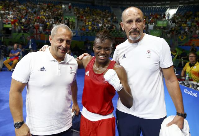 2016 Rio Olympics - Boxing - Final - Women's Fly (51kg) Final Bout 267 - Riocentro - Pavilion 6 - Rio de Janeiro, Brazil - 20/08/2016. Nicola Adams (GBR) of Britain stands with her coaches after winning her bout. REUTERS/Peter Cziborra FOR EDITORIAL USE ONLY. NOT FOR SALE FOR MARKETING OR ADVERTISING CAMPAIGNS.