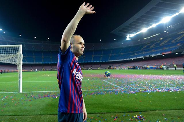 Barcelona's Spanish midfielder Andres Iniesta waves at the end of a tribute after the Spanish league football match between FC Barcelona and Real Sociedad at the Camp Nou stadium (AFP Photo/Josep LAGO)