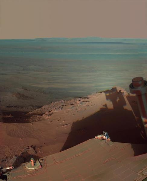 NASA's Mars Rover Opportunity catches its own late-afternoon shadow in this dramatically lit view eastward across Endeavour Crater on Mars. Most of the component images were recorded during the 2,888th Martian day, or sol, of Opportunity's work