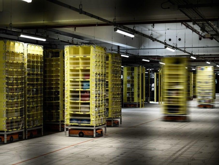 Amazon is increasingly using robots to staff its warehouses and fulfilment centres, meaning Black Friday 2020 strikes and protests may be less effective than previous years (AFP via Getty Images)