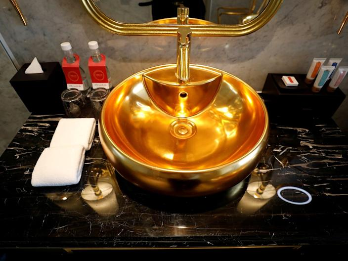 A gold-plated bathroom sink is seen in the Dolce Hanoi Golden Lake luxury hotel in Hanoi, Vietnam, on July 2, 2020.