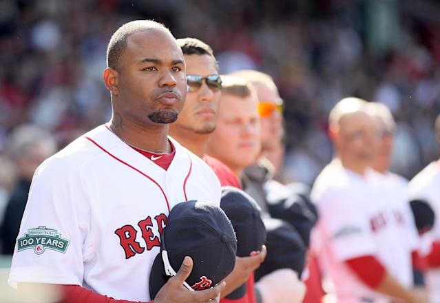 BOSTON, MA - APRIL 13: Carl Crawford #13 of the Boston Red Sox and the rest of his teammates stand in the seventh inning stretch against the Tampa Bay Rays during the home opener on April 13, 2012 at Fenway Park in Boston, Massachusetts. (Photo by Elsa/Getty Images)