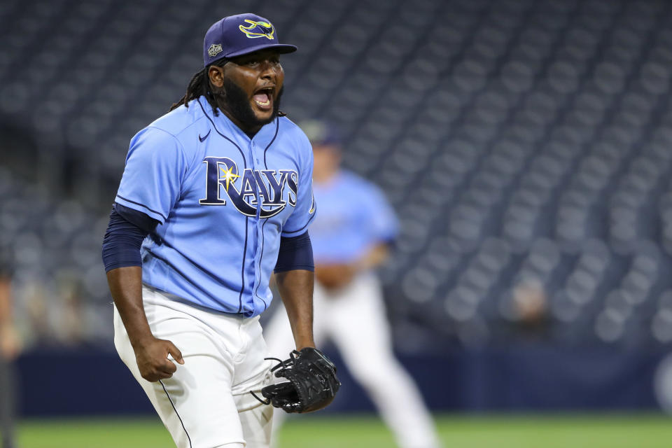 SAN DIEGO, CA - OCTOBER 11: Diego Castillo #63 of the Tampa Bay Rays celebrates after beating the Houston Astros in Game 1 of the ALCS at Petco Park on Sunday, October 11, 2020 in San Diego, California. (Photo by Alex Trautwig/MLB Photos via Getty Images)