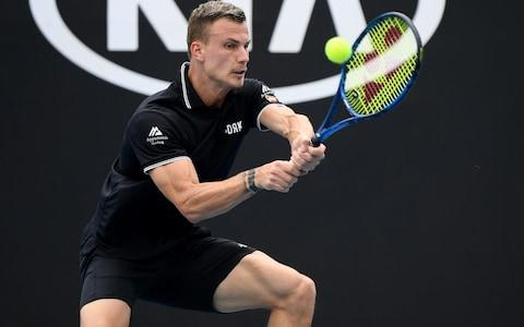 Marton Fucsovics of Hungary plays a backhand during his Men's Singles third round match against Tommy Paul of the United States